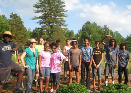 Retreat participants pose in the Silver Lake garden after planting time.